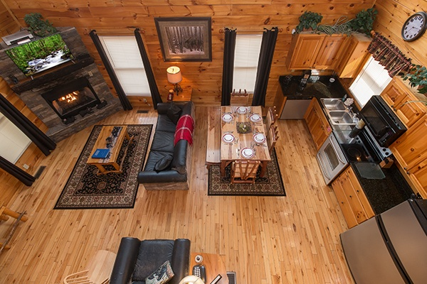Overhead living room, dining room, and kitchen from upstairs at Country Bear's Getaway, a 3-bedroom cabin rental located in Gatlinburg
