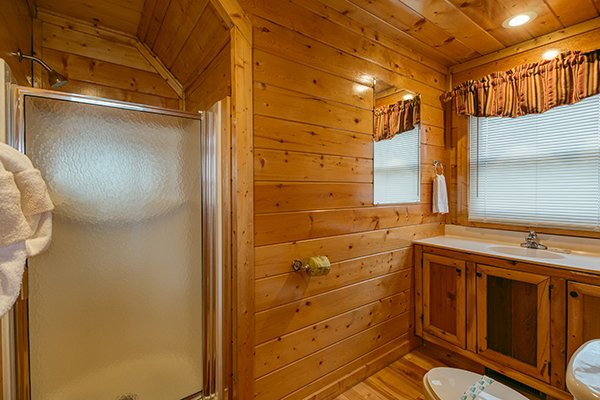 Upstairs bathroom with a shower at Country Bear's Getaway, a 3-bedroom cabin rental located in Gatlinburg