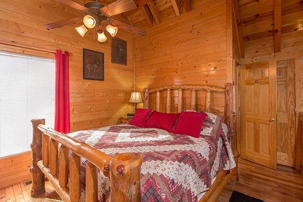 Upstairs bedroom with a log bed at Country Bear's Getaway, a 3-bedroom cabin rental located in Gatlinburg