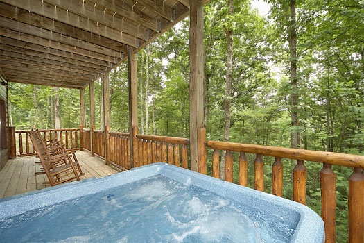 Hot tub on the deck at Country Bear's Getaway, a 3-bedroom cabin rental located in Gatlinburg
