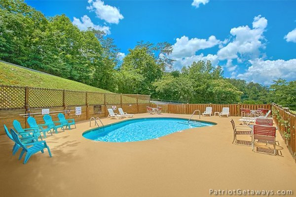 Guests at Howlin' in the Smokies, a 2 bedroom cabin rental located in Pigeon Forge can access the pool with deck lounge chairs at Starr Crest Resort