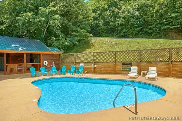 Guests at Howlin' in the Smokies, a 2 bedroom cabin rental located in Pigeon Forge have access to the pool at Starr Crest Resort