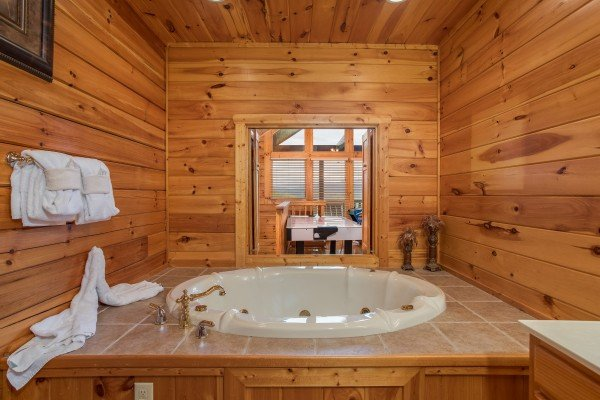 Jacuzzi in the second floor bathroom at Howlin' in the Smokies, a 2 bedroom cabin rental located in Pigeon Forge