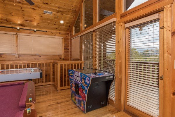 Multicade game at Howlin' in the Smokies, a 2 bedroom cabin rental located in Pigeon Forge