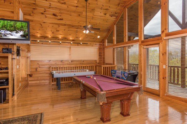 Pool table in the loft space at Howlin' in the Smokies, a 2 bedroom cabin rental located in Pigeon Forge