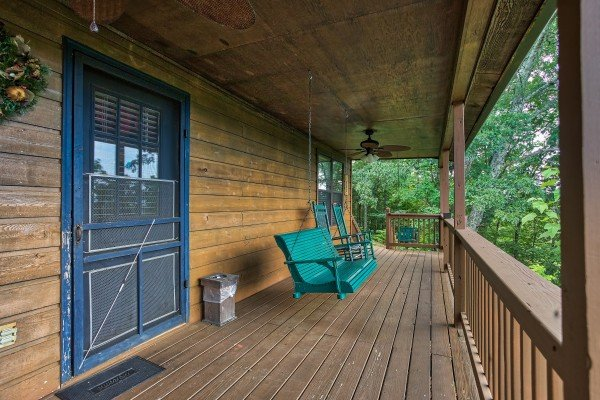 porch swing on a covered deck at america's view a 2 bedroom cabin rental located in pigeon forge
