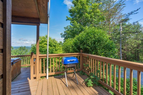 charcoal grill on the deck at america's view a 2 bedroom cabin rental located in pigeon forge