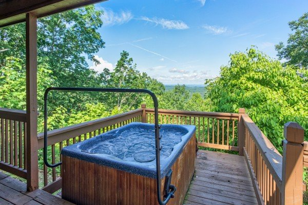 outdoor hot tub with a view at america's view a 2 bedroom cabin rental located in pigeon forge