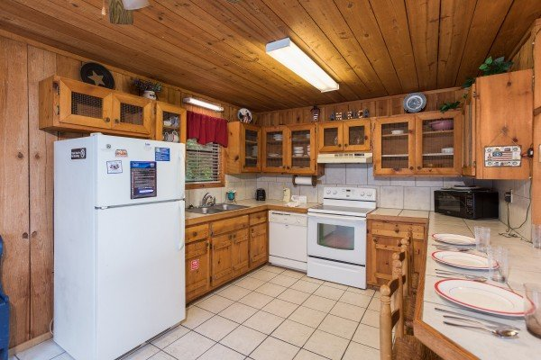 kitchen with white appliances at america's view a 2 bedroom cabin rental located in pigeon forge
