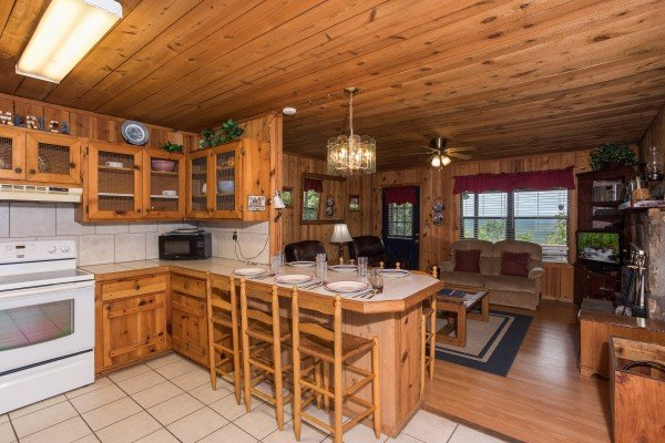 bar top dining for six in the kitchen at america's view a 2 bedroom cabin rental located in pigeon forge