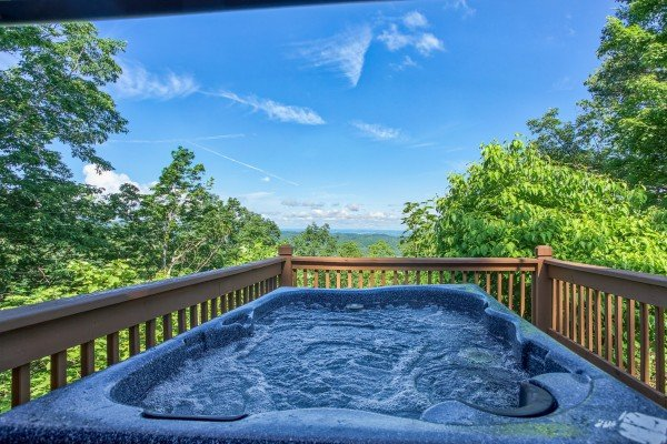 hot tub with a mountain view at america's view a 2 bedroom cabin rental located in pigeon forge
