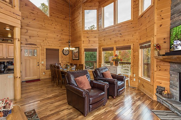 Two arm chairs facing the fireplace in the living room at Southern Sunrise, a 4 bedroom cabin rental located in Pigeon Forge