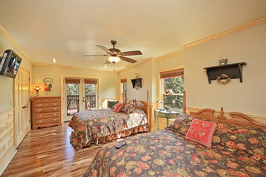 Bedroom with two queen beds at Southern Sunrise, a 4 bedroom cabin rental located in Pigeon Forge