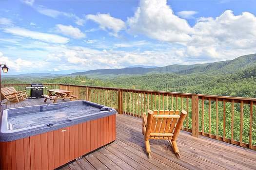 Deck with hot tub at Southern Sunrise, a 4 bedroom cabin rental located in Pigeon Forge