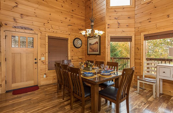 Dining table for eight at Southern Sunrise, a 4 bedroom cabin rental located in Pigeon Forge