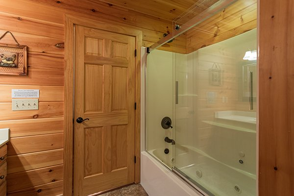 Bathroom with a tub and shower at Southern Sunrise, a 4 bedroom cabin rental located in Pigeon Forge