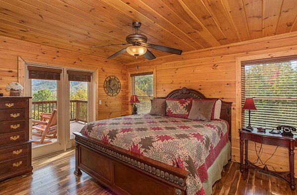 King bedroom with dresser and deck access at Southern Sunrise, a 4 bedroom cabin rental located in Pigeon Forge