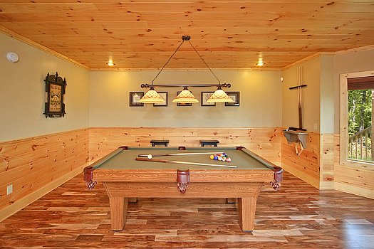 First floor game room with pool table at Southern Sunrise, a 4 bedroom cabin rental located in Pigeon Forge