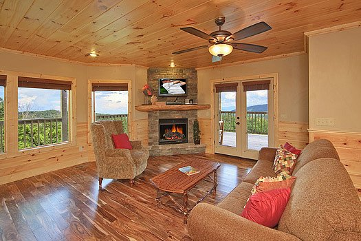 First floor game room with sofa bed at Southern Sunrise, a 4 bedroom cabin rental located in Pigeon Forge