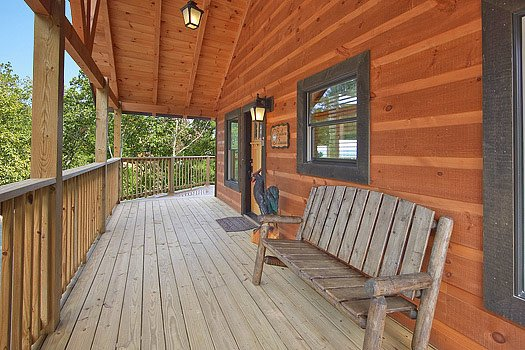 Front porch with bench at Southern Sunrise, a 4 bedroom cabin rental located in Pigeon Forge