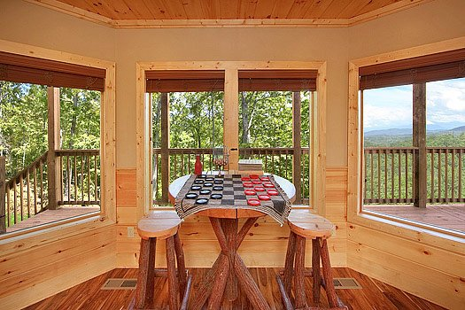 Game room checkers table at Southern Sunrise, a 4 bedroom cabin rental located in Pigeon Forge