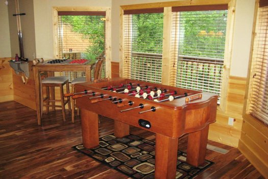 Game room with foosball table at Southern Sunrise, a 4 bedroom cabin rental located in Pigeon Forge