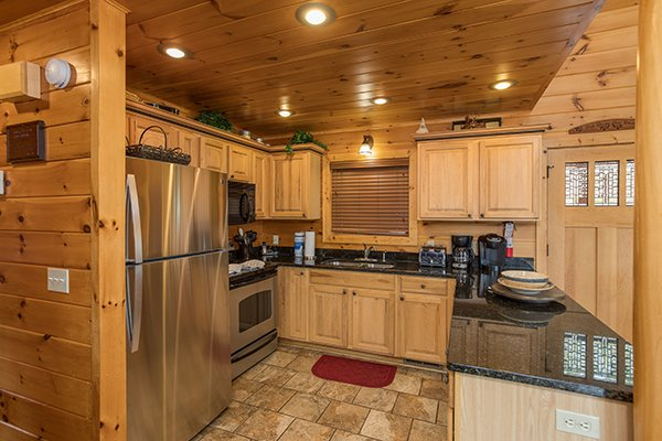 Kitchen with stainless appliances and granite counters at Southern Sunrise, a 4 bedroom cabin rental located in Pigeon Forge