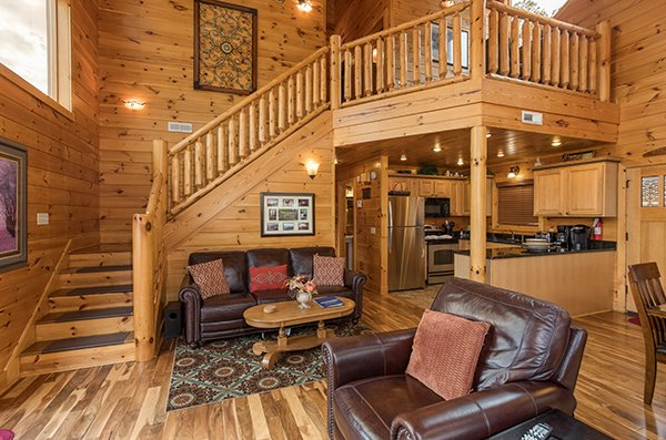 Open concept main floor with living room, dining space, and kitchen at Southern Sunrise, a 4 bedroom cabin rental located in Pigeon Forge