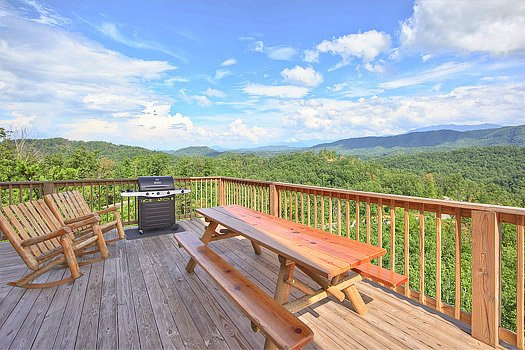 Main level deck with picnic table and grill at Southern Sunrise, a 4 bedroom cabin rental located in Pigeon Forge