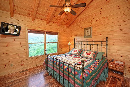 Third floor king bedroom at Southern Sunrise, a 4 bedroom cabin rental located in Pigeon Forge