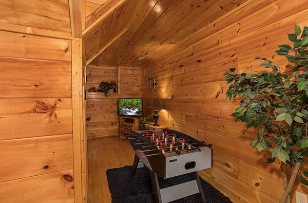 Foosball table and a television at Just Relax, a 2 bedroom cabin rental located in Pigeon Forge