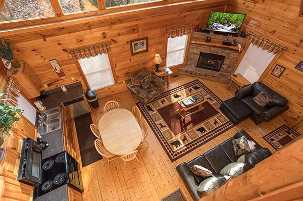 Looking down at the main living space from the loft at Just Relax, a 2 bedroom cabin rental located in Pigeon Forge