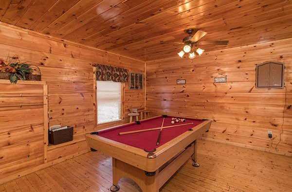 Red felt pool table in the game room at Just Relax, a 2 bedroom cabin rental located in Pigeon Forge