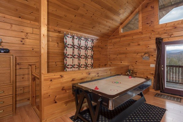 Air hockey table in the loft bedroom at Precious View, a 1 bedroom cabin rental located in Gatlinburg