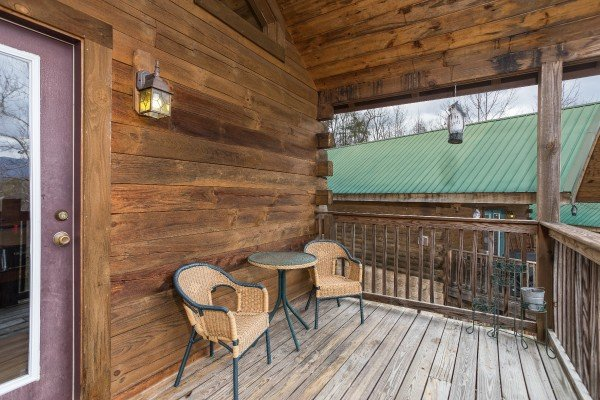 Bistro set on a covered deck at Precious View, a 1 bedroom cabin rental located in Gatlinburg