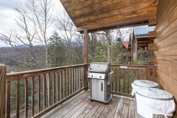 Gas grill on a covered deck at Precious View, a 1 bedroom cabin rental located in Gatlinburg