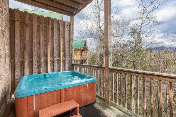 Hot tub on a covered deck with privacy fence at Precious View, a 1 bedroom cabin rental located in Gatlinburg