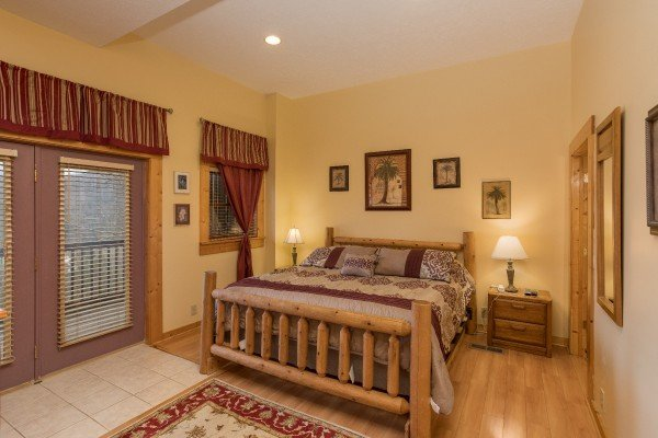 King log bed on the first floor at Precious View, a 1 bedroom cabin rental located in Gatlinburg