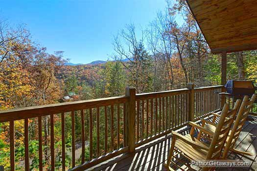 Main level deck with rockers at Precious View, a 1 bedroom cabin rental located in Gatlinburg