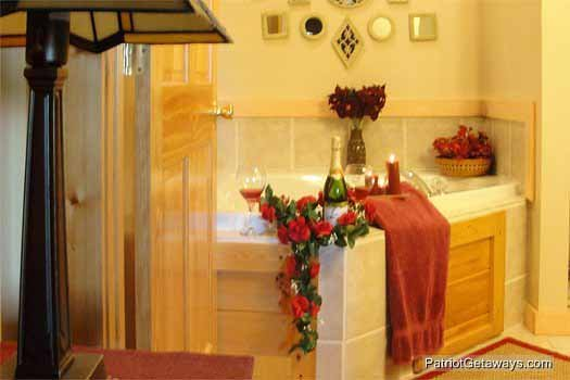 master bath with jacuzzi tub at precious view a 1 bedroom cabin rental located in gatlinburg