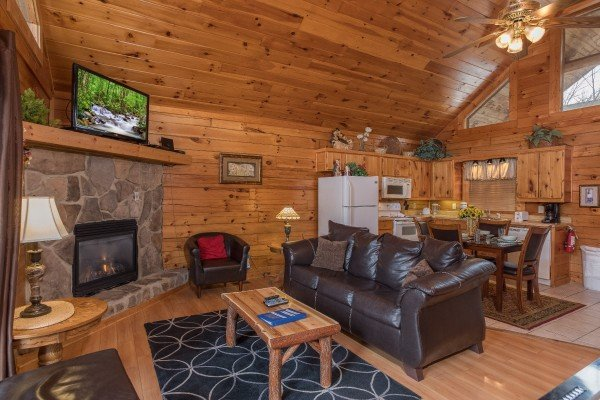 Living room, dining space, and kitchen at Precious View, a 1 bedroom cabin rental located in Gatlinburg