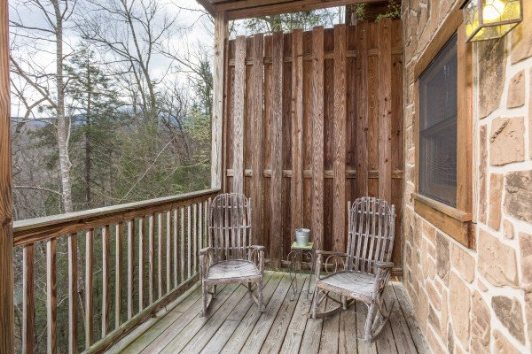 Rocking chairs in front of a privacy fence at Precious View, a 1 bedroom cabin rental located in Gatlinburg