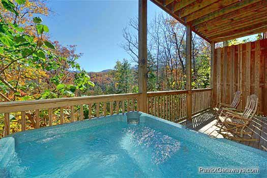 smoky mountain view from hot tub at precious view a 1 bedroom cabin rental located in gatlinburg