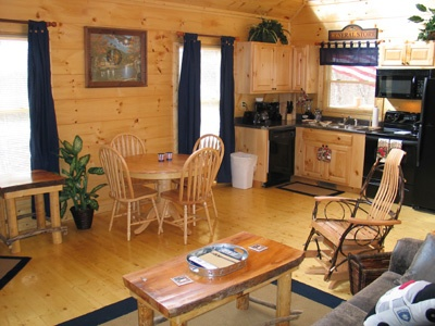 dining table with seats for four at hero's hideaway a 1 bedroom cabin rental located in gatlinburg