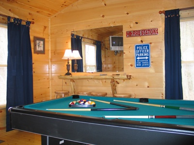 pool table with bar in lofted game room at hero's hideaway a 1 bedroom cabin rental located in gatlinburg