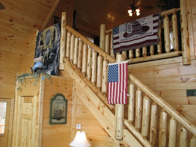 staircase up to lofted game room at hero's hideaway a 1 bedroom cabin rental located in gatlinburg