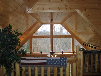 view from the lofted game room at hero's hideaway a 1 bedroom cabin rental located in gatlinburg