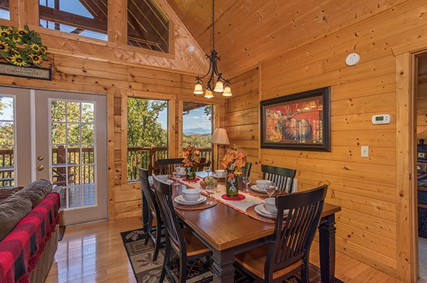 Dining table for six at Southern Comfort Inn, a 4 bedroom cabin rental located in Pigeon Forge