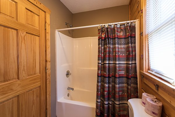 Bathroom with a tub and shower at Southern Comfort Inn, a 4 bedroom cabin rental located in Pigeon Forge
