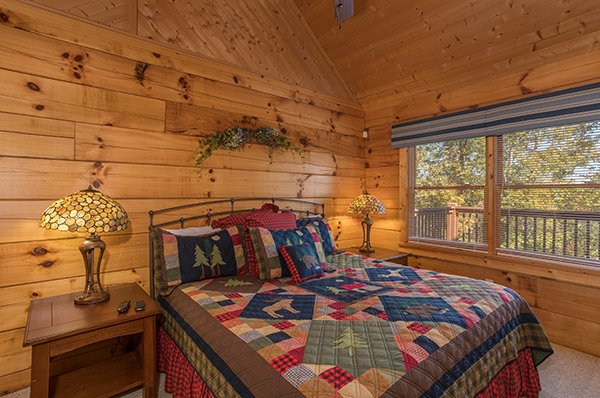 Bedroom with a king bed at Southern Comfort Inn, a 4 bedroom cabin rental located in Pigeon Forge